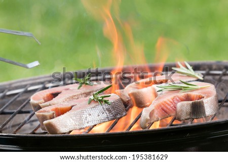 Grilled salmon steaks on the grill, close-up. - stock photo