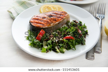 grilled salmon steaks served...