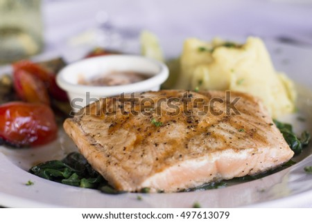 Grilled salmon, vegetables and mashed potatoes
