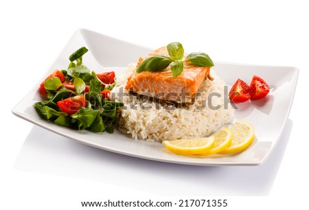 Grilled salmon, white rice and vegetables - stock photo