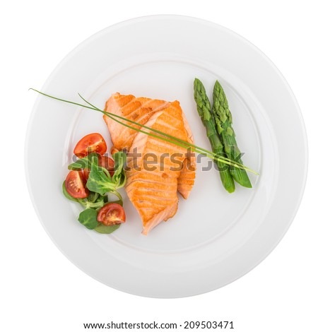 Grilled salmon with asparagus and vegetables isolated on white background. Clipping path - stock photo