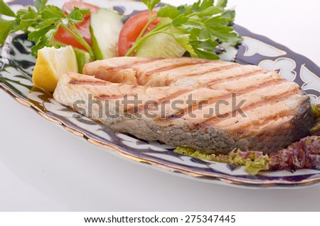 grilled salmon with asparagus, pea, yellow peppers, carrots and spring onions - stock photo