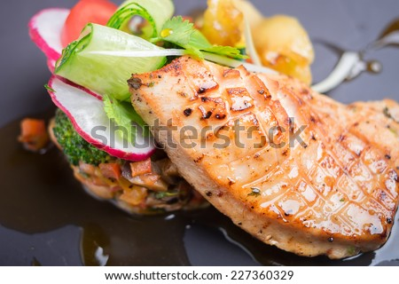 Grilled salmon with assorted vegetables - stock photo