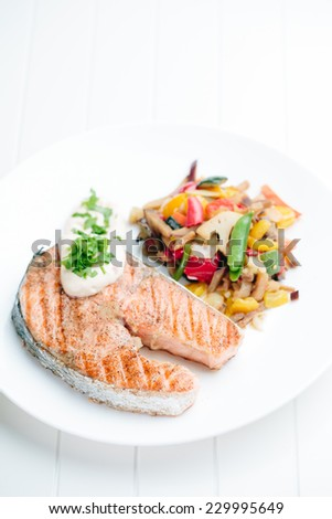 Grilled Salmon with Fresh vegetables on white background - stock photo
