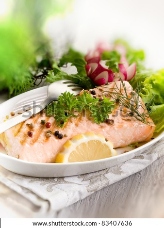 grilled salmon with green salad - stock photo