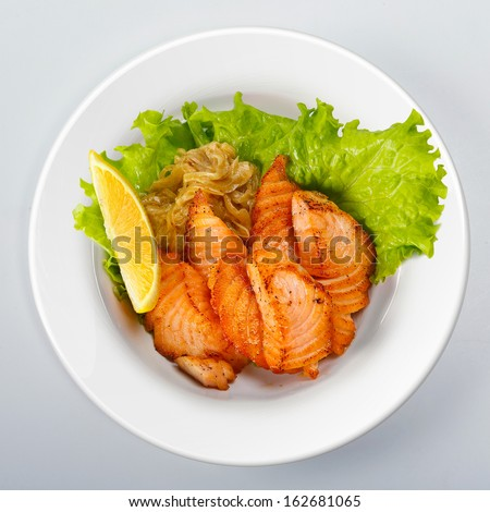 Grilled salmon with green salad top view - stock photo