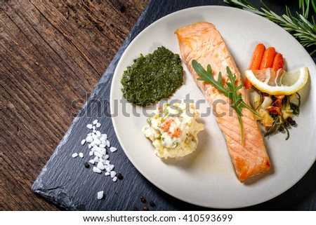 Grilled Salmon with lemon, herbs and pesto. Red carrots. Potato salad.