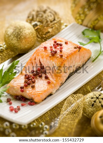 grilled salmon with pink pepper on christmas table - stock photo