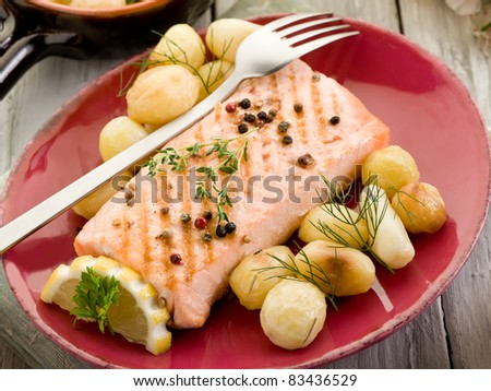 grilled salmon with roasted potatoes - stock photo