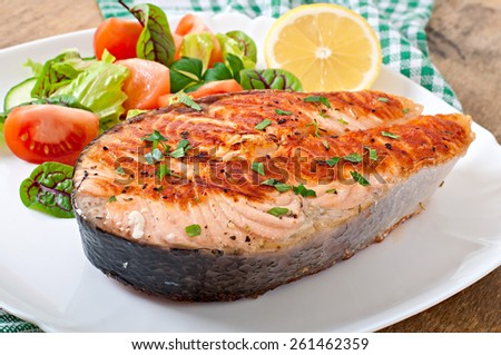 Grilled salmon with salad. - stock photo