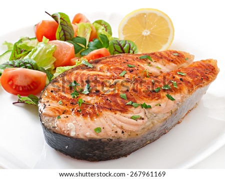 Grilled salmon with salad - stock photo