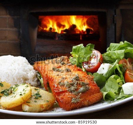 Grilled salmon with salad and rice - stock photo