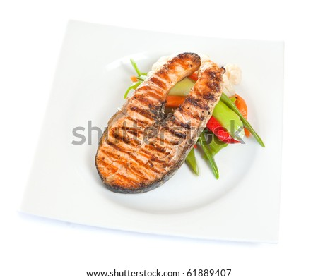 Grilled salmon with salad in plate - stock photo