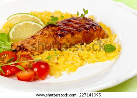 Grilled salmon with seasoned rice on White Background. Selective focus. - stock photo