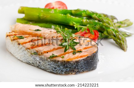 Grilled salmon with vegetables   on a white plate. Selective focus