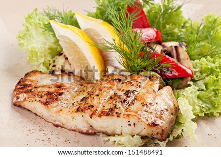 Grilled salmon with vegetables  with vegetables on the plate  - stock photo