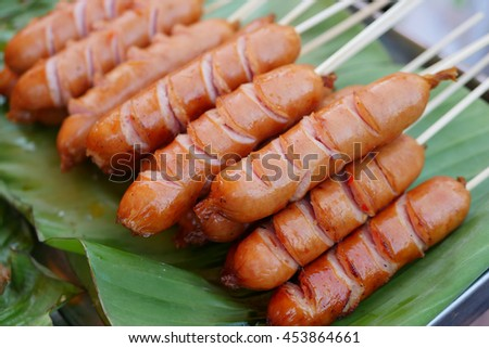 grilled sausage, asian street food - stock photo