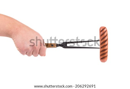 Grilled sausage on a fork. Isolated on a white background. - stock photo