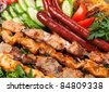 Grilled sausage with sauce and vegetables - stock photo