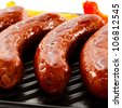 Grilled sausages and vegetables - stock photo