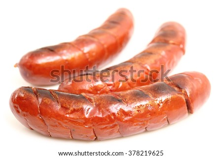 Grilled sausages isolated on a white background - stock photo