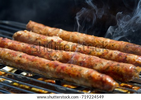 Grilled sausages, on grill, top view, barbecue party, catering.