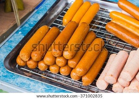grilled sausages. View from above.on trays - stock photo