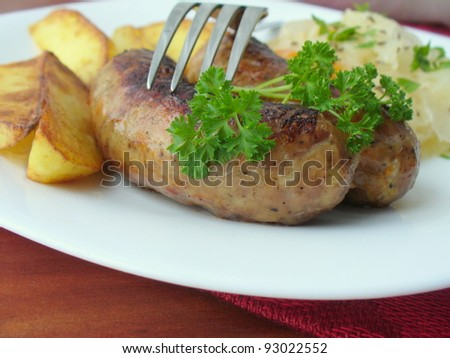 Grilled sausages with potato and cabbage