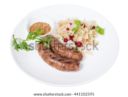 Grilled sausages with sauerkraut and mustard. Isolated on a white background.
