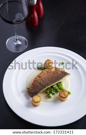 Grilled sea-bass with bean and grill mashed potato in white sauce