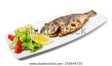 Grilled sea bass with lemon and herbs. Isolated on a white background.. - stock photo