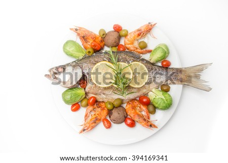 grilled sea bass with tomato, cabbage, shrimp, olive, kemon, rosemary, brown mushroom, rice, and salad. - stock photo