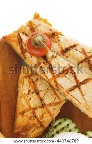 grilled sea fish salmon with french edam gorgonzola and soft feta goat cheeses on wooden plate isolated over white background - stock photo