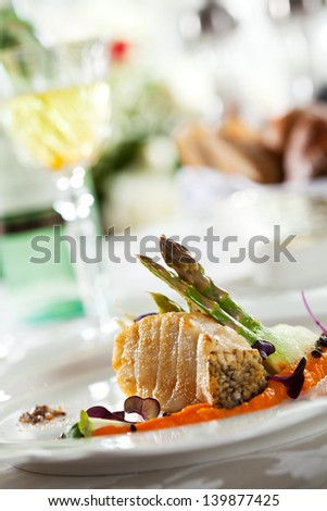 Grilled Seabass with Carrots Mash and Asparagus - stock photo