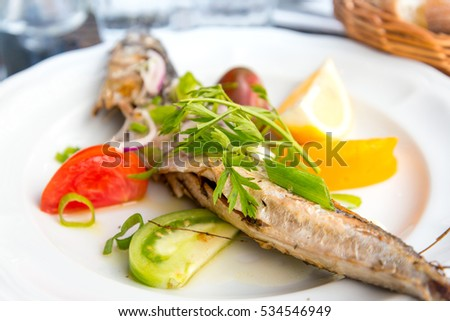 grilled seafood and vegetables-french cuisine dish with many vegetables