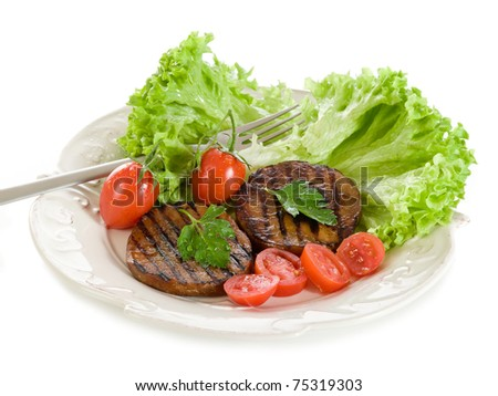 grilled seitan with tomatoes and salad - stock photo