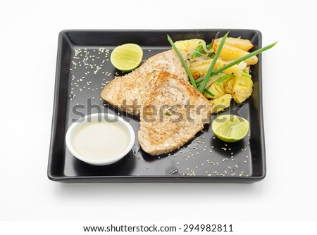 Grilled shark with baked potatoes isolated on white