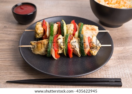 Grilled shish kebab with safron rice - stock photo