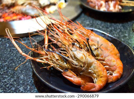 Grilled Shrimp in a plate on barbecue the table - stock photo
