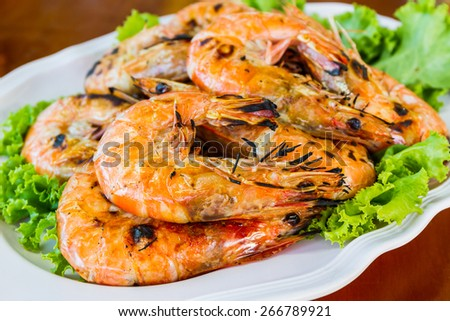 Grilled Shrimp in a plate on the wood table. - stock photo