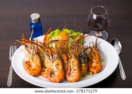 Grilled Shrimp multiple white dish with vegetables. - stock photo