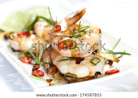 Grilled shrimp with garlic, rosemary and chili. - stock photo