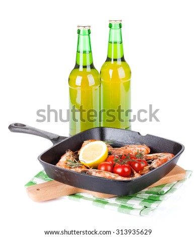 Grilled shrimps on frying pan and beer. Isolated on white background - stock photo