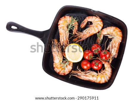 Grilled shrimps on frying pan. Isolated on white background - stock photo