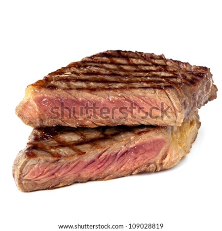 Grilled sirloin steak, cut in half, isolated on white.