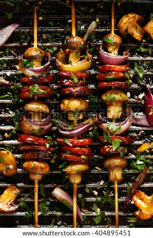Grilled Skewers of  sausage, mushrooms and onion on grill pan - stock photo
