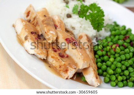 grilled slices of turkey meat with green pea and rice