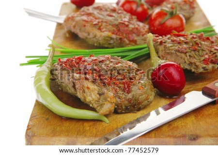 grilled spicy meat on wood over white - stock photo