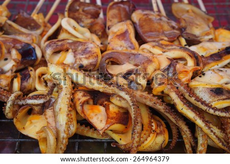 Grilled squid on skewer in the market - stock photo