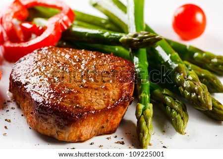 Grilled steak and asparagus - stock photo